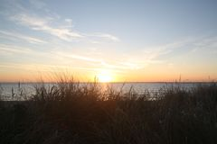 Sunrise by the sea with a blue sky. stock image