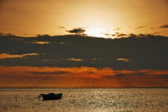 Sunrise at sea in Camargue. Sunrise over the sea with boat in the Camargue Royalty Free Stock Images