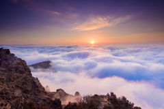 Sunrise in the sea of clouds Stock Photos