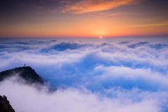 Sunrise in the sea of clouds Royalty Free Stock Image