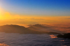 Sunrise with sea of clouds Stock Image