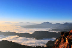 Sunrise with sea of clouds. Sea of clouds pictures in china Minya Konka Mountains in Tibetan Plateau Stock Image