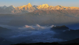Sunrise with sea of clouds. Sea of clouds pictures in china Minya Konka Mountains in Tibetan Plateau Royalty Free Stock Images