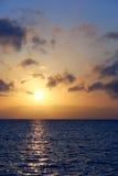 Sunrise sea coast. Sunrise sea view, sun is reflected in water Royalty Free Stock Photos