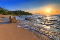 Sunrise on sea coast Stock Image