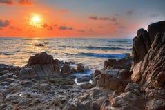 Sunrise on sea coast Stock Photos