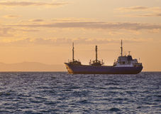 Sunrise at sea and the fishing vessel Royalty Free Stock Images