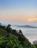 Sunrise with sea of fog above Mekong river Royalty Free Stock Image