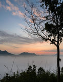 Sunrise with sea of fog over mountain Stock Images