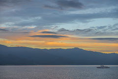 Sunrise on the Sea of Japan. Niigata, Japan - August 12, 2014: Japan Coast Guard ship sailing in the bay of Sado island during sunrise,Nigata prefecture royalty free stock photography