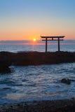 Sunrise and sea at Japanese shinto gate Royalty Free Stock Photo