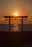 Sunrise and sea at Japanese shinto gate Royalty Free Stock Photos