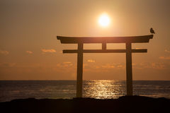 Sunrise and sea at Japanese shinto gate Stock Photos