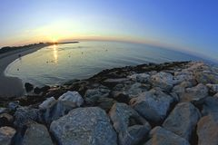 Sunrise on the sea with large colorful Sun with fisheye lens Stock Photo