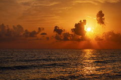 Sunrise in the sea Stock Images