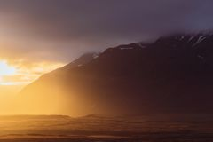 Sunrise in the Sea and Mountain Stock Images