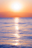 Sunrise and sea. Sunrise over the mountains and reflection in sea water royalty free stock photography