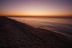 Sunrise on the sea Stock Images