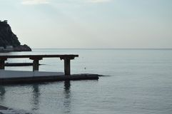 Sunrise at the sea, pier on the shore in the early morning, calm, relax.  royalty free stock image