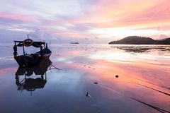 Sunrise sea reflection with boat in George Town, Penang Malaysia. Beautiful landscape series of sunrise and sunset collection from George Town, Penang, Malaysia Royalty Free Stock Photo