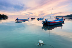 Sunrise sea reflection with boat in George Town, Penang Malaysia. Beautiful landscape series of sunrise and sunset collection from George Town, Penang, Malaysia Stock Photo