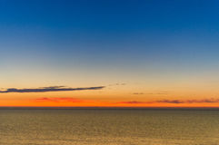 Sunrise at sea shore. Colorful sky stock photos