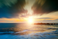 Sunrise at sea with surf, Stock Photography