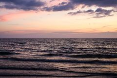 Sunrise in the sea with waves royalty free stock photography