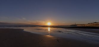 Sunrise at Seaburn in the north east of England stock images