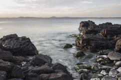Sunrise seascape. Long exposure seascape at sunrise with rocks Stock Photo