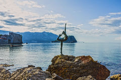 Sunrise seascape - old town Budva, Montenegro - ballerina statue Royalty Free Stock Photography