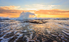 Sunrise seascape splash in the shape of a wave royalty free stock photos