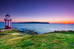 Sunrise seascape view with lighthouse at sunrise Stock Photography