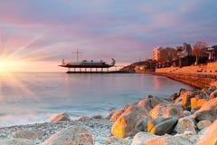 Sunrise on the seaside promenade Royalty Free Stock Images