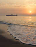 Sunrise at seaside with a shipwreck Royalty Free Stock Images