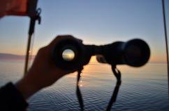 Sunrise seen through binoculars Stock Images