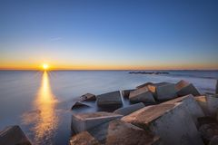 Sunrise seen from the breakwater on the city beach stock photo
