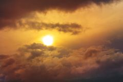 Sunrise shines through a orange thunder clouds royalty free stock photos