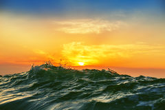 Sunrise and shining waves in ocean. Sunrise light shining on ocean wave Stock Photography