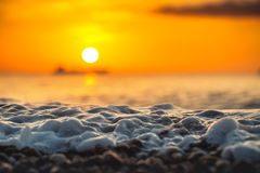 Sunrise and shining waves in ocean Royalty Free Stock Images