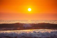 Sunrise and shining waves in ocean. Sunrise shot Stock Photo