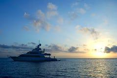 Sunrise ship. Yacht in ocean at sunrise Royalty Free Stock Photos