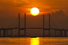 Sunrise by the shore of Penang Bridge, George Town, Penang. Amazing Sunrise and Sunset in Penang Bridge George Town, Penang Malaysia Royalty Free Stock Image