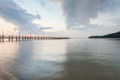 Sunrise by the shore with sea foreground. In Penang Stock Image