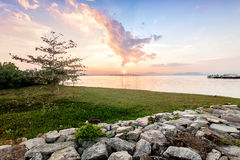 Sunrise by the shore with sea foreground. In Penang Royalty Free Stock Image