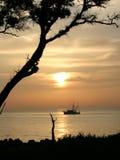 Sunrise and shrimp. Sunrise over the Atlantic Ocean and a Shrimp Boat royalty free stock photo