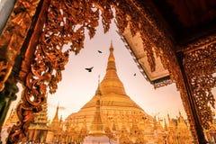 Sunrise at the Shwedagon Pagoda in Yangon. Myanmar Stock Photo