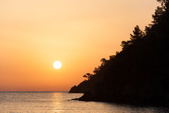 Sunrise silhouette above sea and sky Turkey Stock Image