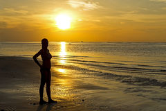 Sunrise silhouette lady Stock Photography