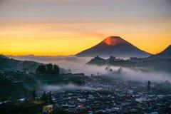 Sunrise. Sindoro with orange blanket , Dieng, Indonesia Royalty Free Stock Image